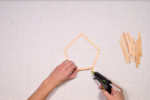 Attach Popsicle sticks
