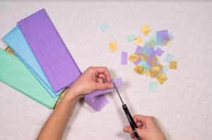 Cut tissue paper into squares