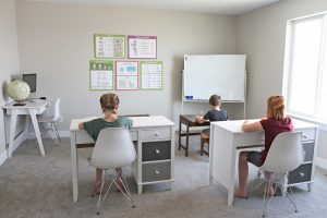 3 kids in a classroom
